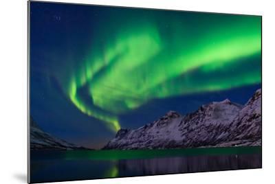 The Aurora Borealis over Water and Mountains-Babak Tafreshi-Mounted Photographic Print