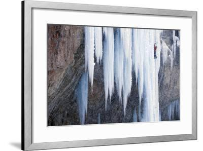 A Man Ice-Climbing an Ice Formation-Keith Ladzinski-Framed Photographic Print
