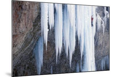A Man Ice-Climbing an Ice Formation-Keith Ladzinski-Mounted Photographic Print