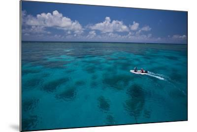 A Dinghy at the Great Barrier Reef-Michael Melford-Mounted Photographic Print