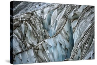 A Blue Iceberg Striped with Streaks of Black-Keith Ladzinski-Stretched Canvas Print
