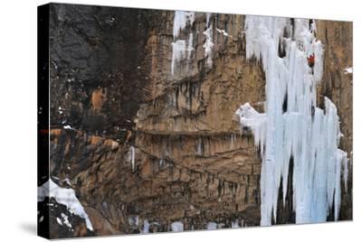 A Man Ice-Climbing-Keith Ladzinski-Stretched Canvas Print