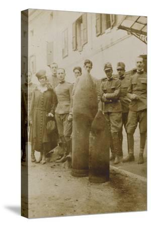 War Campaign 1917-1920: Campolongo January 1919 , Group Photo in Front of Big Bullets--Stretched Canvas Print
