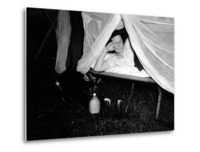 American Wac Raises the Netting over Her Cot as a Photographer's Flash Illuminates the Scene--Metal Print