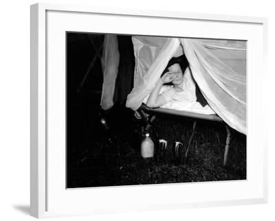 American Wac Raises the Netting over Her Cot as a Photographer's Flash Illuminates the Scene--Framed Photo