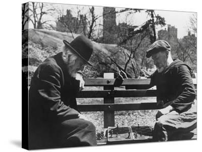 Two Old-Timers Playing Chess on a Central Park Bench in New York City, May 1946--Stretched Canvas Print