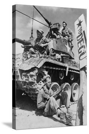 U.S. Soldiers Guard a Roadblock on the Naktong River Front in the Taegu Area with an M-24 Tank--Stretched Canvas Print