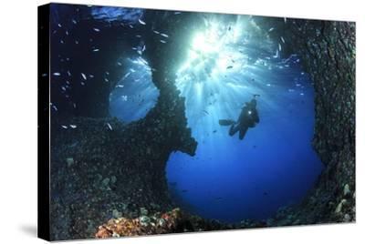Scuba Diver Swimming through an Arch-Bernard Radvaner-Stretched Canvas Print