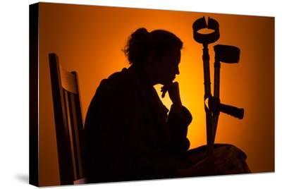 Woman Seated with Crutches-Anthony West-Stretched Canvas Print