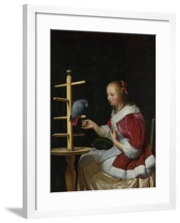 A Woman in a Red Jacket Feeding a Parrot, Ca 1663-Frans van Mieris the Elder-Framed Giclee Print