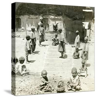 Children Playing Hopscotch, Kashmir, India, C1900s-Underwood & Underwood-Stretched Canvas Print