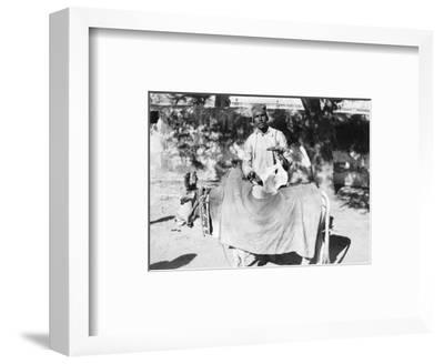 Man with a Deformed Cow, India, 1916-1917--Framed Giclee Print