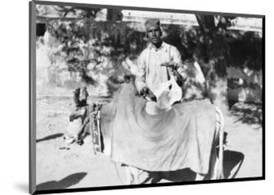 Man with a Deformed Cow, India, 1916-1917--Mounted Giclee Print