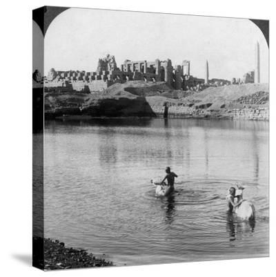 Looking across the Sacred Lake to the Great Temple at Karnak, Thebes, Egypt, 1905-Underwood & Underwood-Stretched Canvas Print