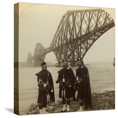 Men in Highland Dress in Front of the Forth Bridge, Scotland-Underwood & Underwood-Stretched Canvas Print