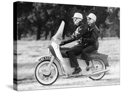 A Man and a Woman Riding an Ariel Leader, 1958--Stretched Canvas Print