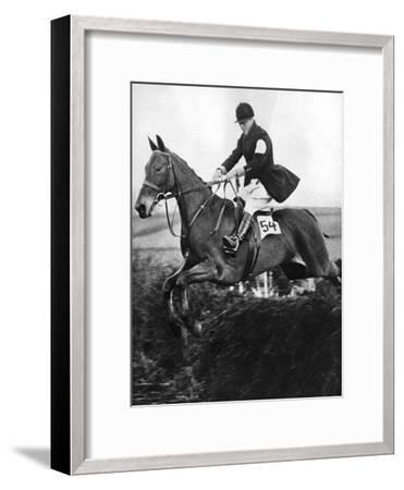 The Prince of Wales Taking a Fence in the Bridge of Guards Challenge Cup Race, C1930S--Framed Giclee Print