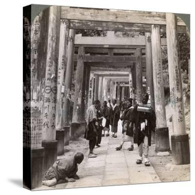 Coming and Going under Long Rows of Sacred Torii, Shinto Temple of Inari, Kyoto, Japan, 1904-Underwood & Underwood-Stretched Canvas Print