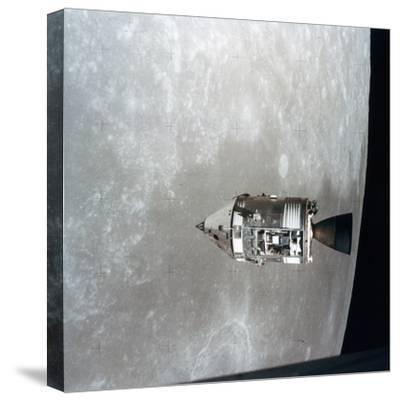 The Apollo 15 Command and Service Modules in Lunar Orbit, 1971--Stretched Canvas Print