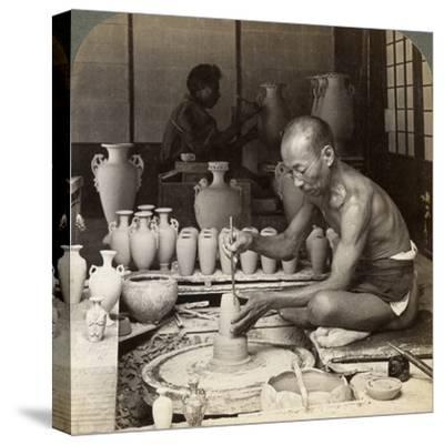 A Potter and His Wheel, Fashioning a Vase of Awata Porcelain, Kinkosan Works, Kyoto, Japan, 1904-Underwood & Underwood-Stretched Canvas Print