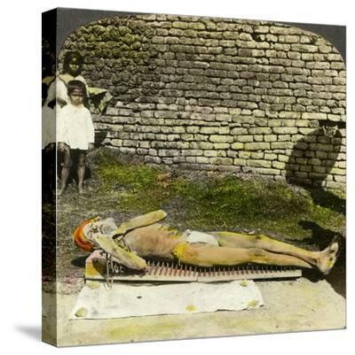 Hindu Devotee on a Bed of Nails Near the Shrine of Kali, Calcutta, India, Early 20th Century-Underwood & Underwood-Stretched Canvas Print