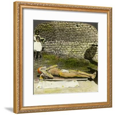 Hindu Devotee on a Bed of Nails Near the Shrine of Kali, Calcutta, India, Early 20th Century-Underwood & Underwood-Framed Giclee Print