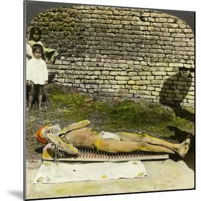 Hindu Devotee on a Bed of Nails Near the Shrine of Kali, Calcutta, India, Early 20th Century-Underwood & Underwood-Mounted Giclee Print