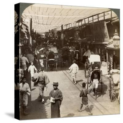 Midsummer Traffic under the Awnings of Shijo Bashidori, a Busy Thoroughfare of Kyoto, Japan, 1904-Underwood & Underwood-Stretched Canvas Print