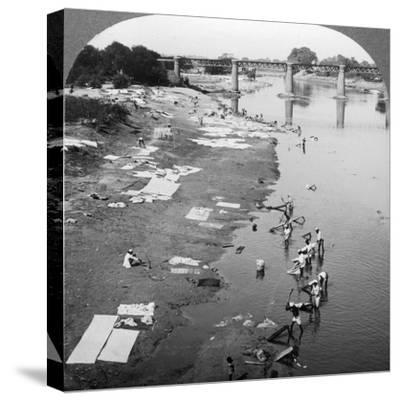 Dbobies Washing Clothes in the Goomti River, Near Lucknow, India, 1900s-Underwood & Underwood-Stretched Canvas Print