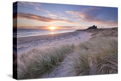 Sunrise over Bamburgh Beach and Castle from the Sand Dunes, Northumberland, England. Spring (March)-Adam Burton-Stretched Canvas Print