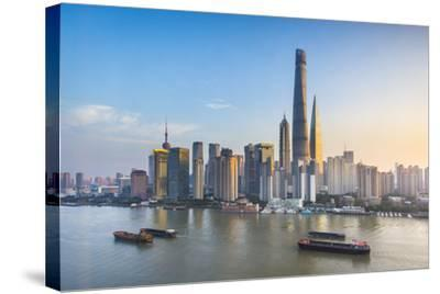 Shanghai Tower and the Pudong Skyline across the Huangpu River, Shanghai, China-Jon Arnold-Stretched Canvas Print
