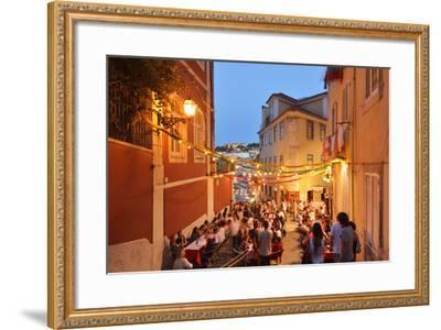 A Restaurant in the Calcada Do Duque, with a View to Sao Jorge Castle at Twilight. Lisbon, Portugal-Mauricio Abreu-Framed Photographic Print