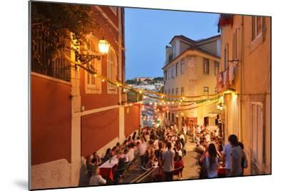 A Restaurant in the Calcada Do Duque, with a View to Sao Jorge Castle at Twilight. Lisbon, Portugal-Mauricio Abreu-Mounted Photographic Print