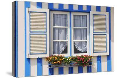 Window of a Traditional Striped Painted House in the Little Seaside Village of Costa Nova, Portugal-Mauricio Abreu-Stretched Canvas Print