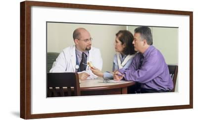Doctor and Couple Seated around a Table Talking-Stocktrek Images-Framed Photographic Print