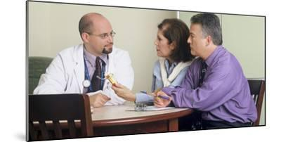 Doctor and Couple Seated around a Table Talking-Stocktrek Images-Mounted Photographic Print