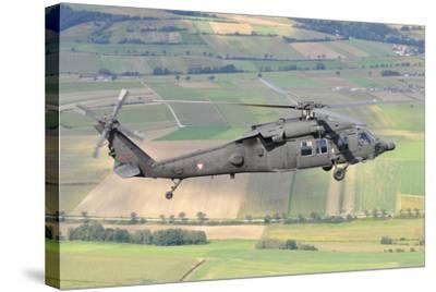 Uh-60 Black Hawk Helicopter of the Austrian Air Force in Flight-Stocktrek Images-Stretched Canvas Print