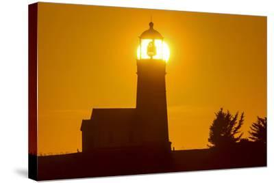 Setting Sun Behind Oregons Oldest Lighthouse at Cape Blanco Sp, Oregon-Chuck Haney-Stretched Canvas Print