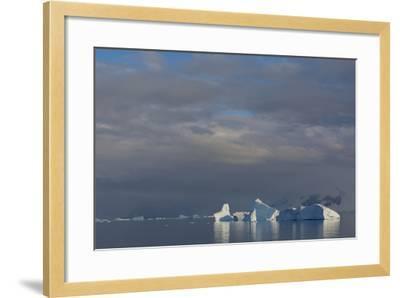 Antarctica. Gerlache Strait. Iceberg and Cloudy Skies-Inger Hogstrom-Framed Photographic Print