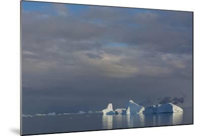 Antarctica. Gerlache Strait. Iceberg and Cloudy Skies-Inger Hogstrom-Mounted Photographic Print