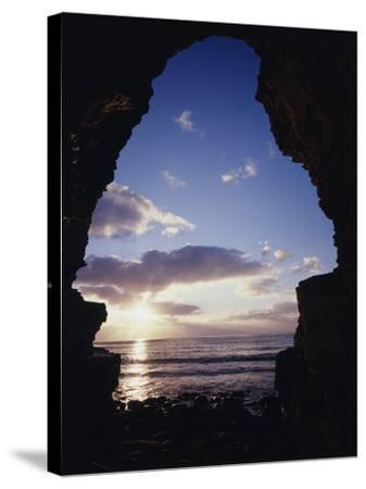 California, San Diego, Sunset Cliffs, Sunset Seen Through a Sea Cave-Christopher Talbot Frank-Stretched Canvas Print