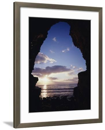 California, San Diego, Sunset Cliffs, Sunset Seen Through a Sea Cave-Christopher Talbot Frank-Framed Photographic Print
