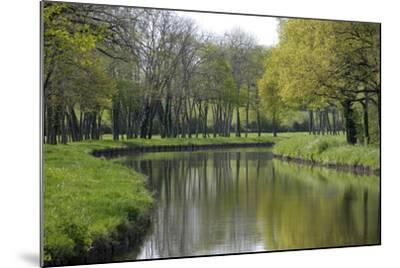 France, Loire. Canal Winding Through Spring Trees and Foliage-Kevin Oke-Mounted Photographic Print