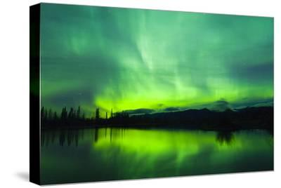 Green Aurora Borealis over Small Pond in Kluane National Park, Yukon Territory, Canada-Design Pics Inc-Stretched Canvas Print