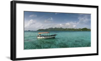 An Outboard Motorboat Adrift in a Clear Blue Water Off Crab Caye-Macduff Everton-Framed Photographic Print