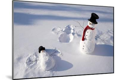 Snowmen in Forest Making Snow Angel Imprint in Snow in Late Afternoon Sunlight Alaska Winter-Design Pics Inc-Mounted Photographic Print
