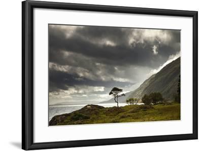 Sunlight Shingin Through the Storm Clouds over the Water Along the Coastline-Design Pics Inc-Framed Photographic Print