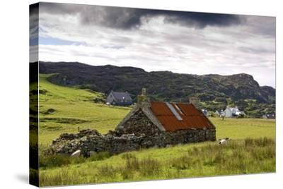 Isle of Colonsay, Scotland; Stone Farmhouse and Surrounding Field-Design Pics Inc-Stretched Canvas Print