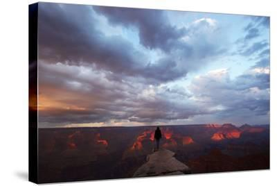A Man Looking Out over the Grand Canyon at Sunrise from a Rock Promontory-Luis Lamar-Stretched Canvas Print