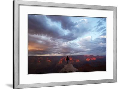 A Man Looking Out over the Grand Canyon at Sunrise from a Rock Promontory-Luis Lamar-Framed Photographic Print